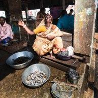 Woman selling fish and singing at the same time, Rangamati fish market, Rangamati, Chittagong Division, Bangladesh, Asia