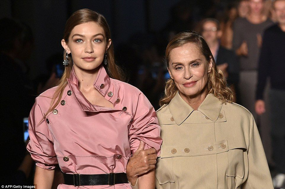 Through the generations: Gigi and Lauren co-ordinated, with the actress in a camel trench coat of similar utility style, to celebrate 50 years of the fashion house's success