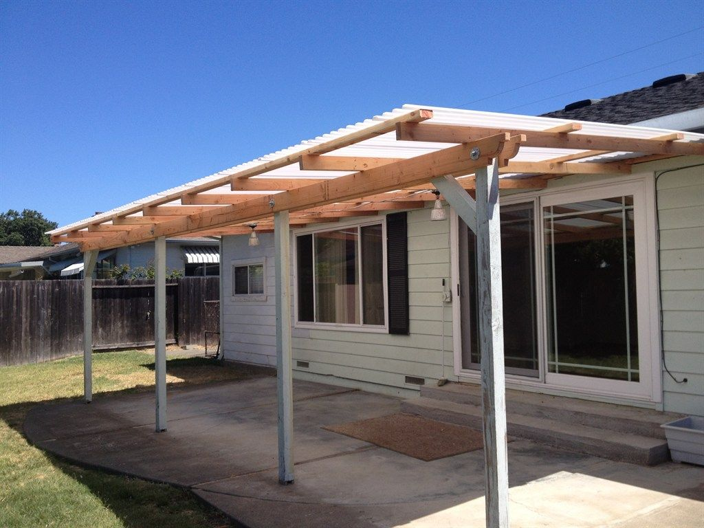 exterior,simple wood awning with 4 columns as front porch in