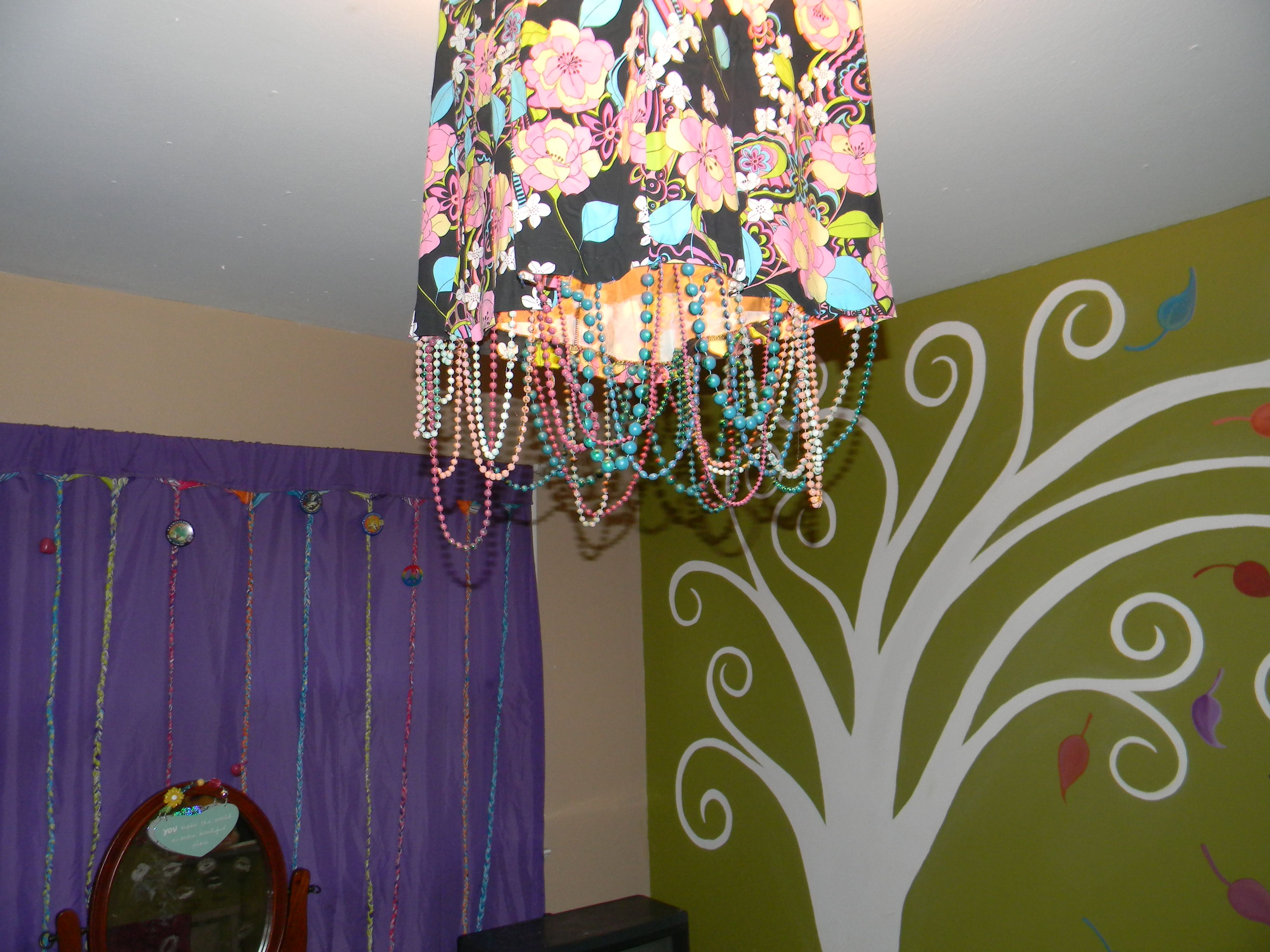 Light fixture made from an old skirt and spray painted mardi gras light fixture made from an old skirt and spray painted mardi gras beads braided curtain arubaitofo Choice Image