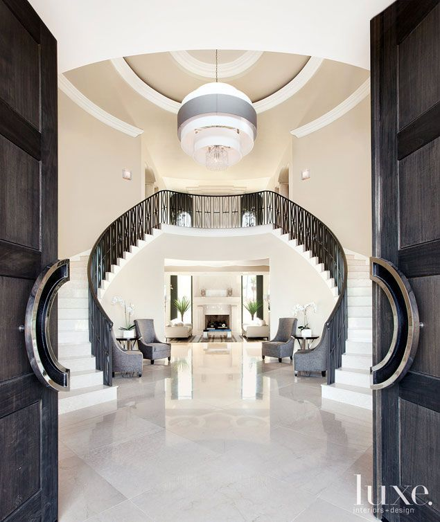 Colorful Staircase Designs 30 Ideas To Consider For A: This Sleek And Shiny Entrance Opens Up To A 24-foot-high