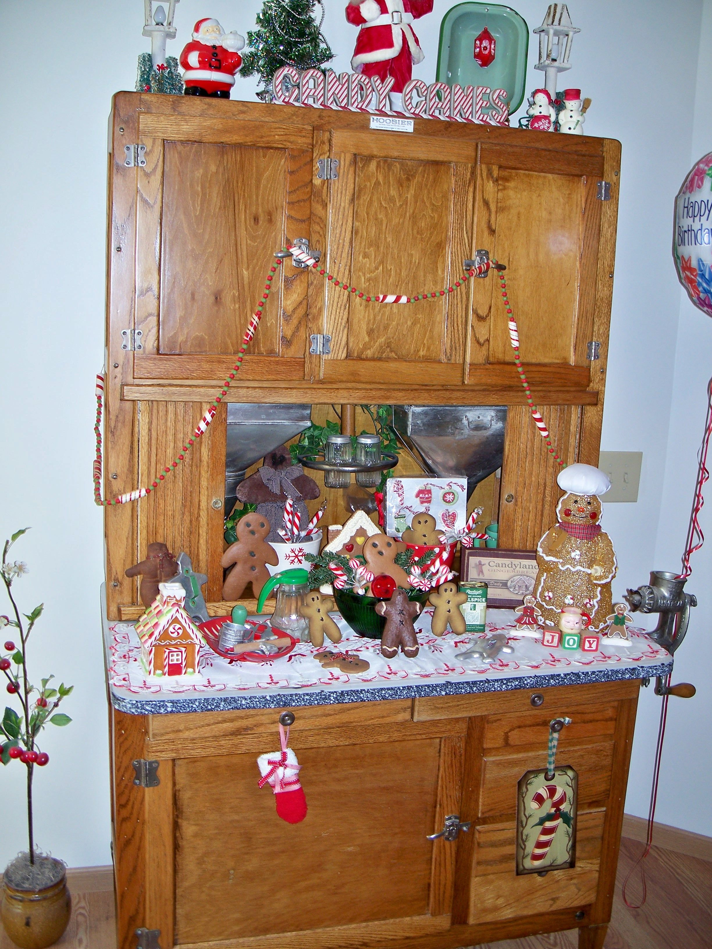 that s it i need a hoosier cabinet for my gingerbread collection gingerbread decorations on kitchen cabinets xmas decor id=91442
