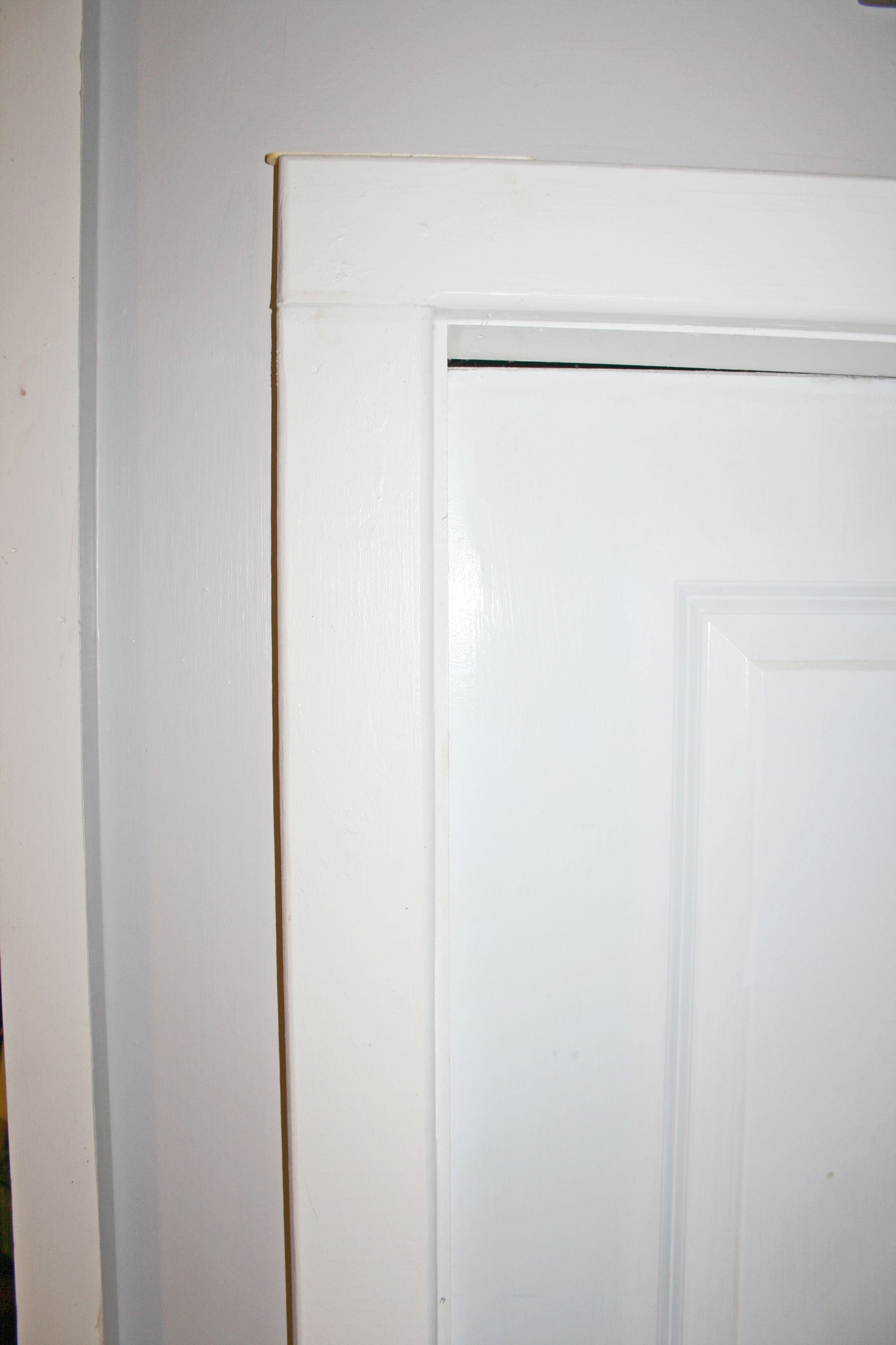 Keep popsicle sticks on the top of each door frame to