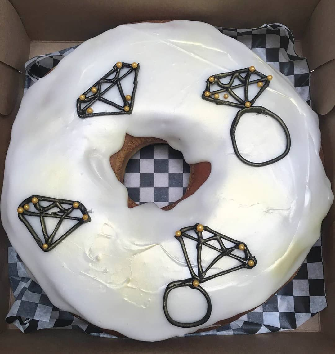 Pretty doughnut engagement cake by @ve 💍 ° ° °