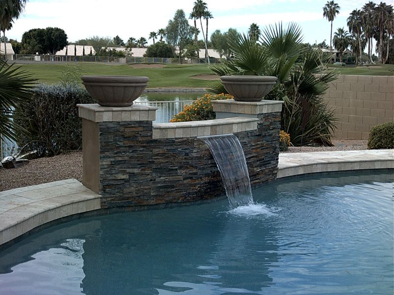 waterfall feature into swimming pool