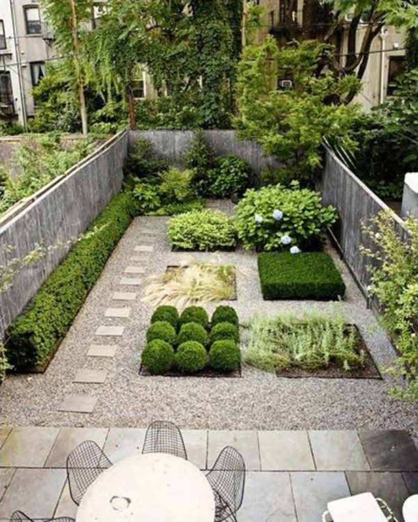 Grey Stamped Concrete Patio With Unique Shrubs For Modern