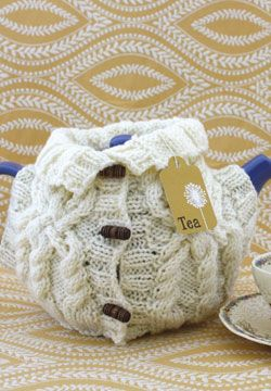 Practice your cables on this miniature aran sweater, which cleverly uses the neck and armholes for the handle and spout!