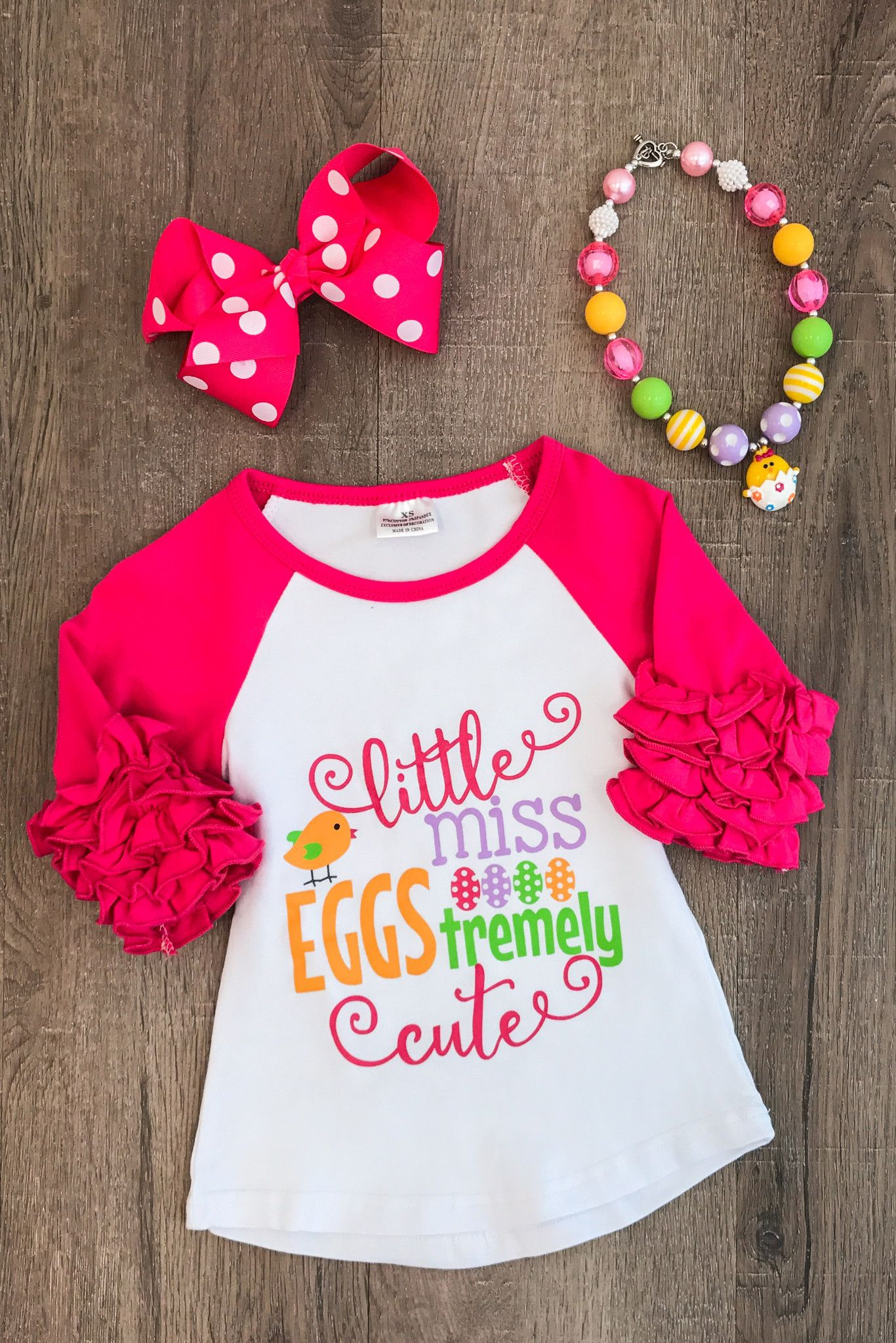 3 4 Sleeve Little Miss Eggstremely Cute Shirt From Sparkle In Pink Our Adorable Hot Pink Ruff With Images Baby Girl Easter Outfit Girls Easter Shirt Girls Easter Dresses