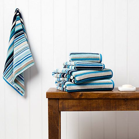 """Great inspiration for a nautical bathroom design - love the white wood panelled wall (looks like a beach hut!) and the """"Harlequin Barcode"""" towels are from johnlewis.com"""
