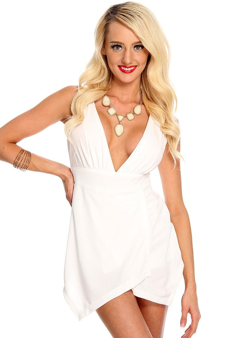 Every girl should own a little white romper in their wardrobe! This look  will sure f85b6def1