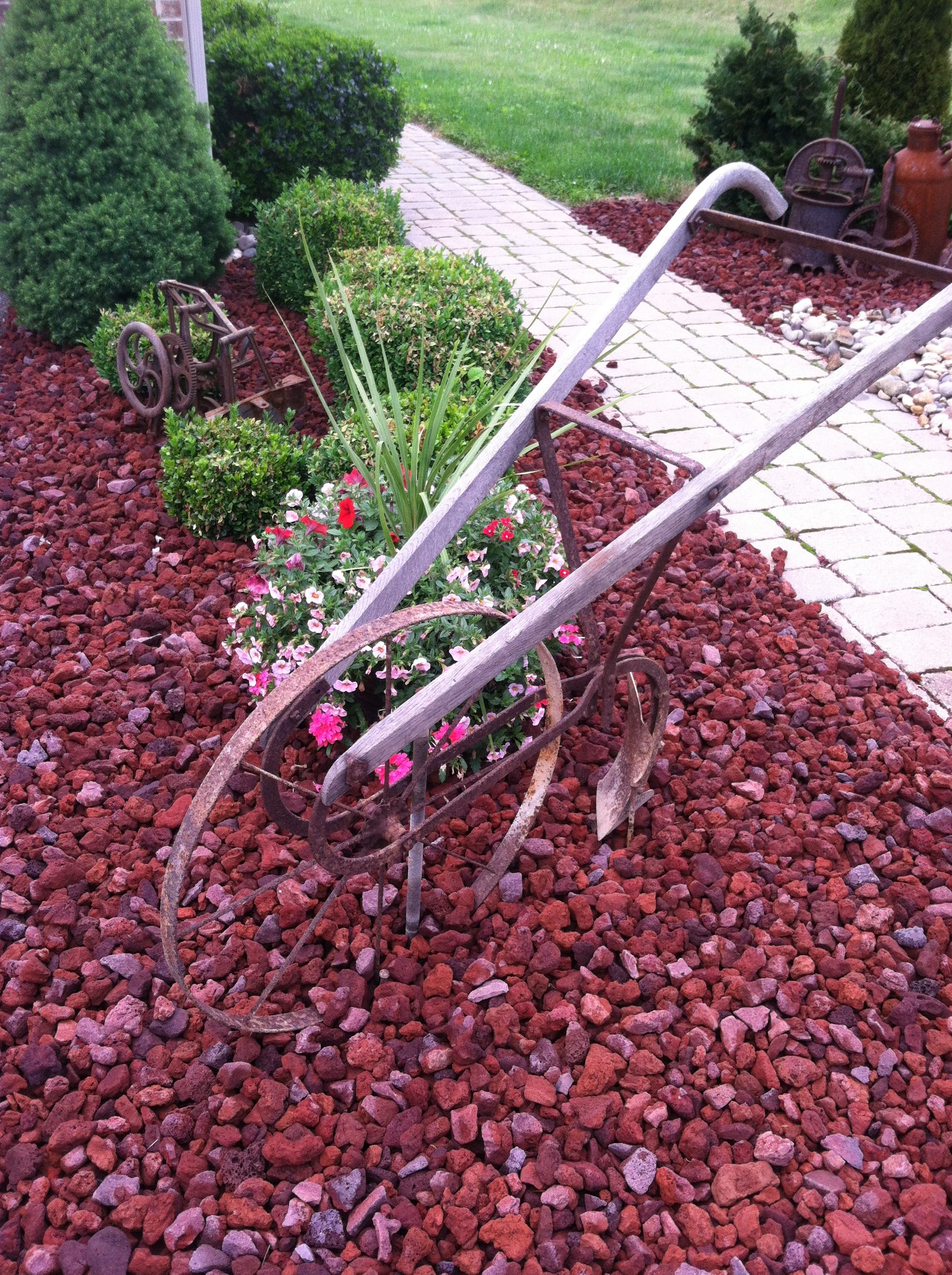 Antique hand plow Landscaping with rocks, Antique