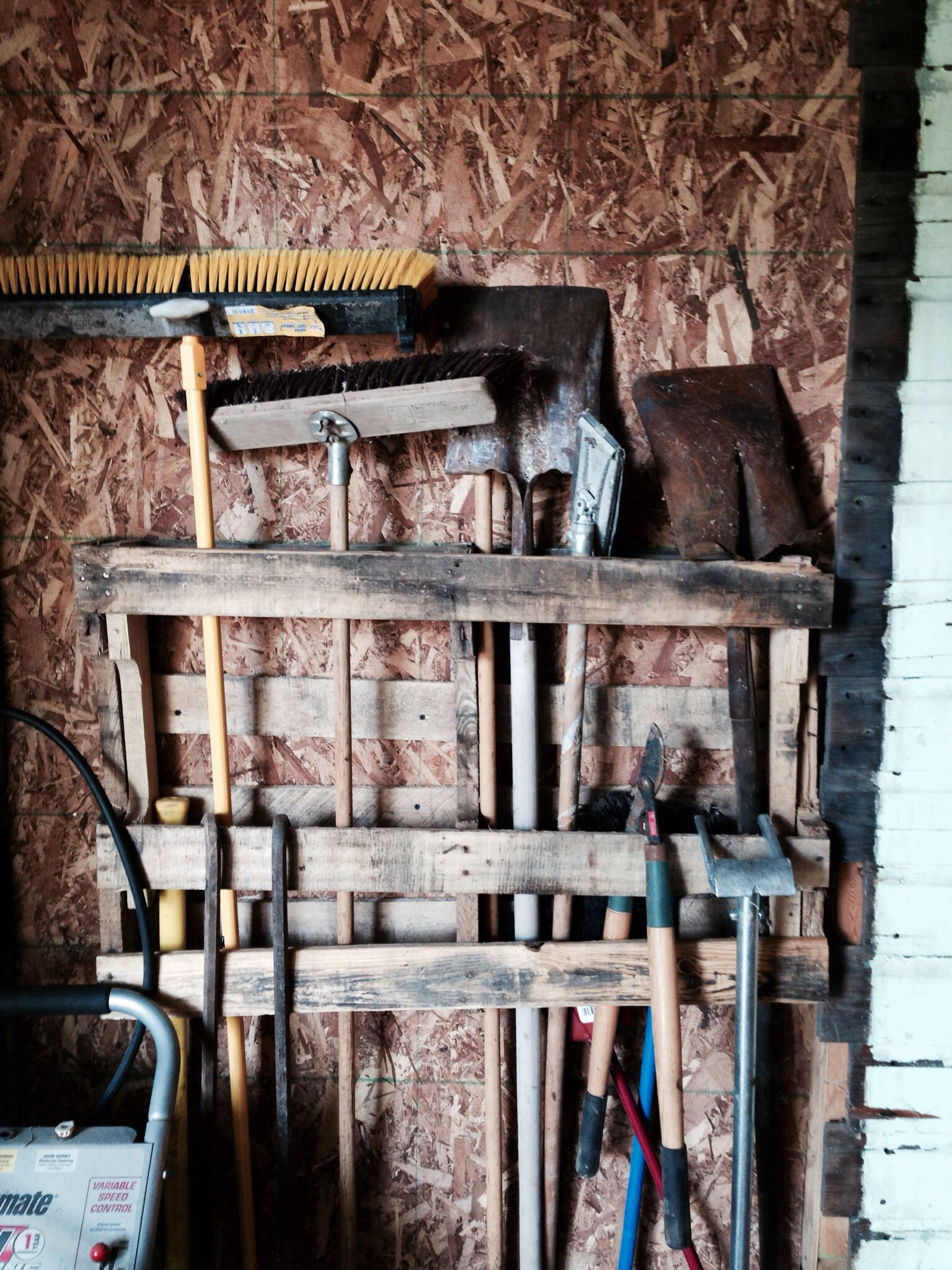 Simple way to use a pallet as a garage organizer for your ...