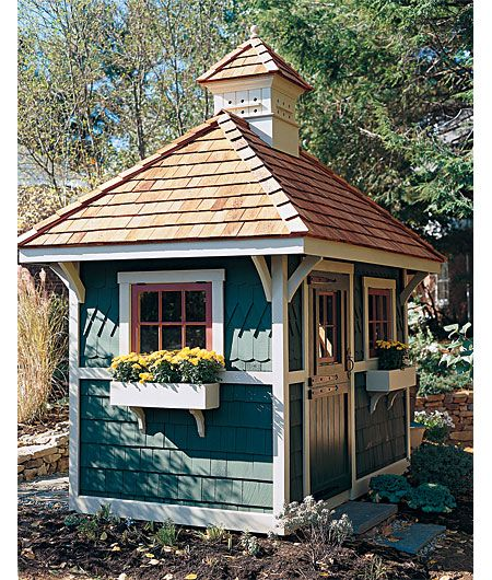 Cute garden shed with flower boxes