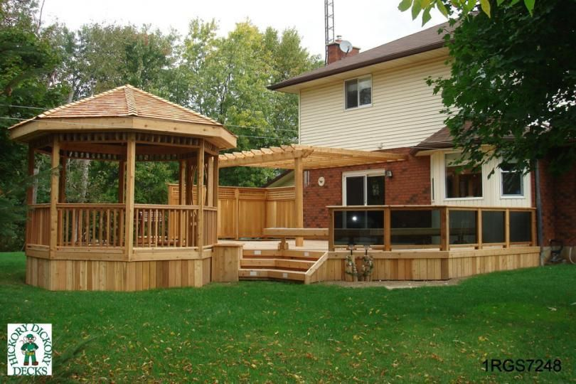 Large 1 level deck with a spa pergola bench planters for Diy hot tub gazebo