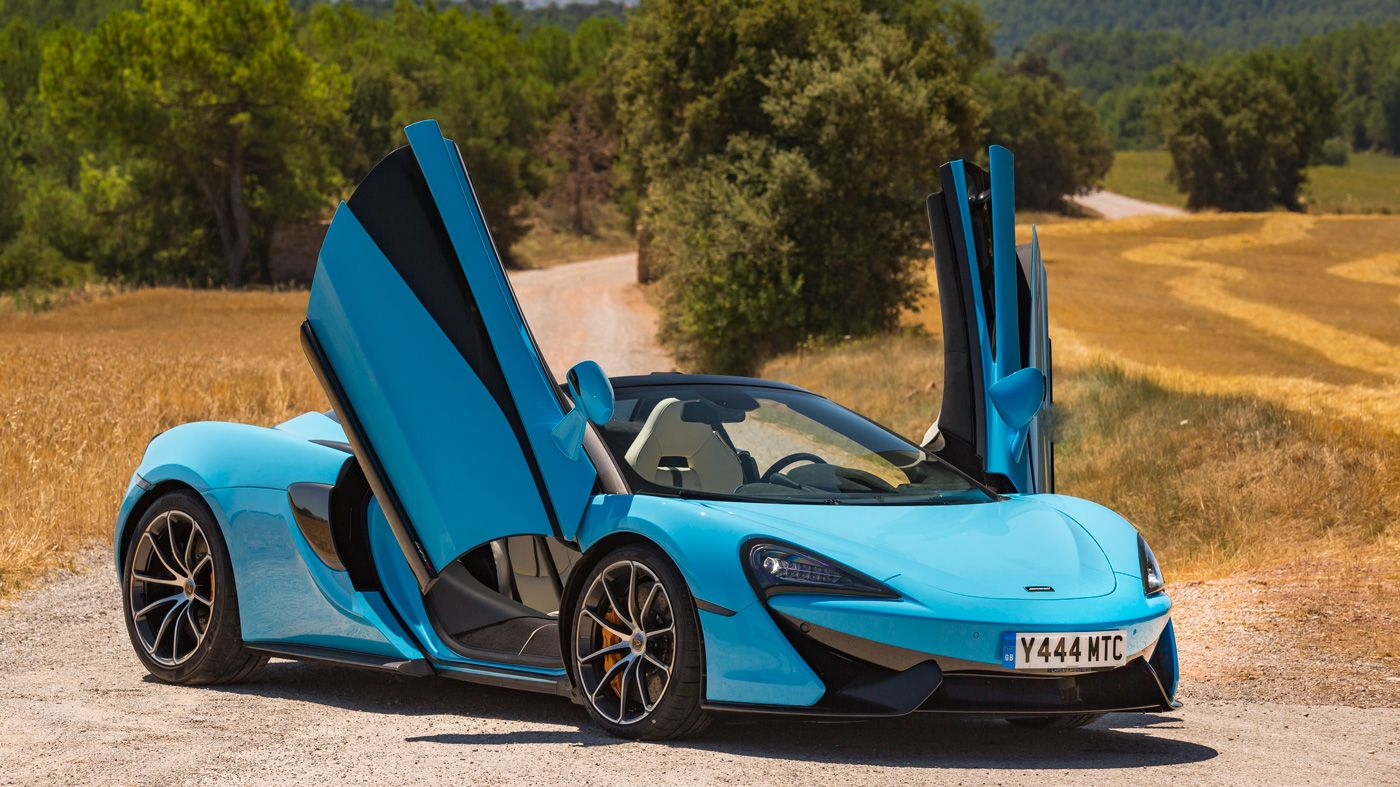 An image of the McLaren 570S Spider\u0027s dihedral doors on full display. & An image of the McLaren 570S Spider\u0027s dihedral doors on full display ...