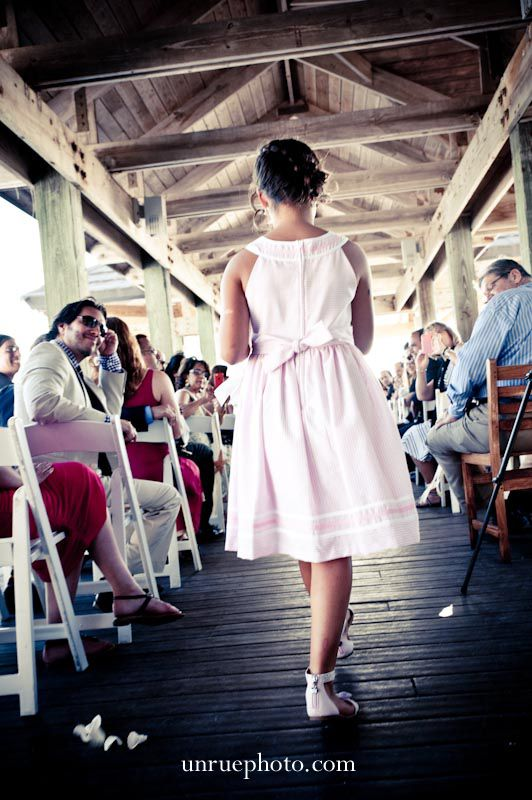 Flower girl walking down the isle.  #weddingphotography