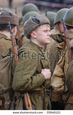 Man wears historical Soviet uniform as he participates in a
