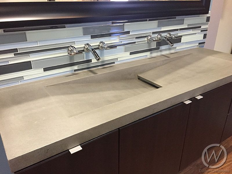 This is a double faucet trough sink with a single drain. It\'s a ...