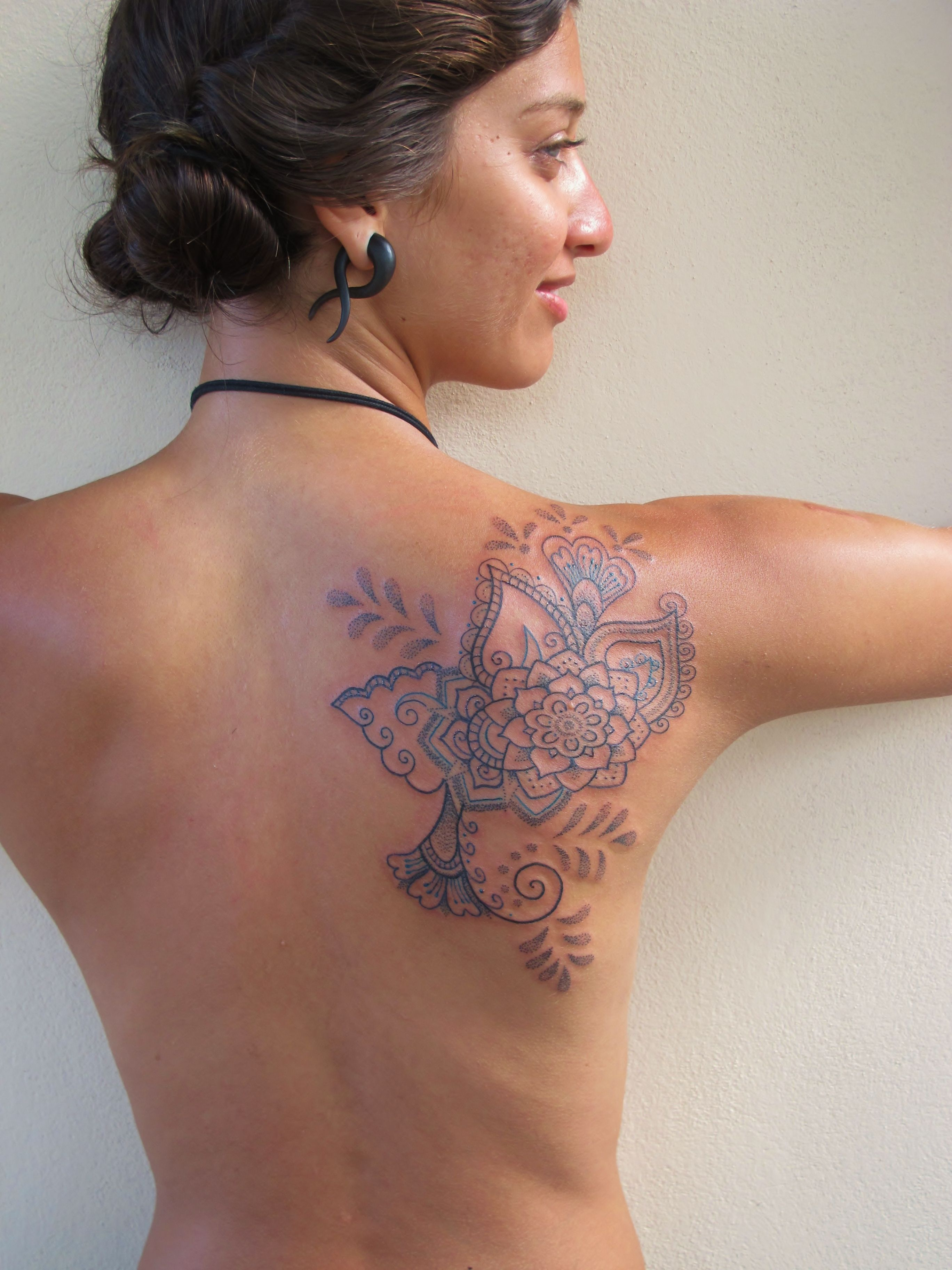 A freehand mehndi style shoulder tattoo that plans to grow a whole