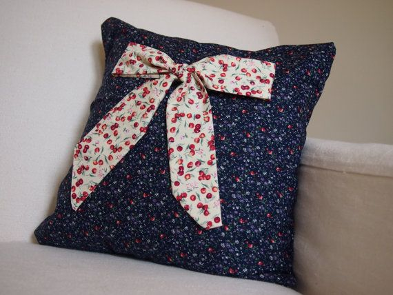Pretty cushion with appliqué bow by Nightingale & Dolittle