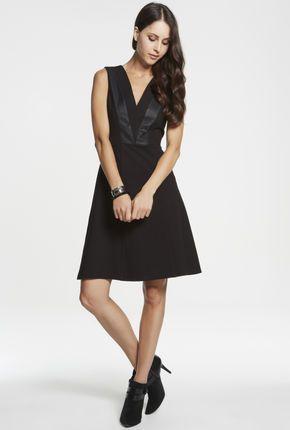 I love the neck line of this dress PU Spliced Ponti Dress — Maxshop.com $149