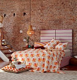I really like the orange up against the exposed brick in this photo