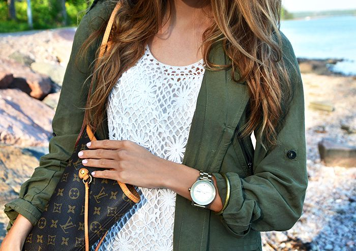 White crochet dress, olive green utility jacket, Louis Vuitton Monogram Neverfull tote bag