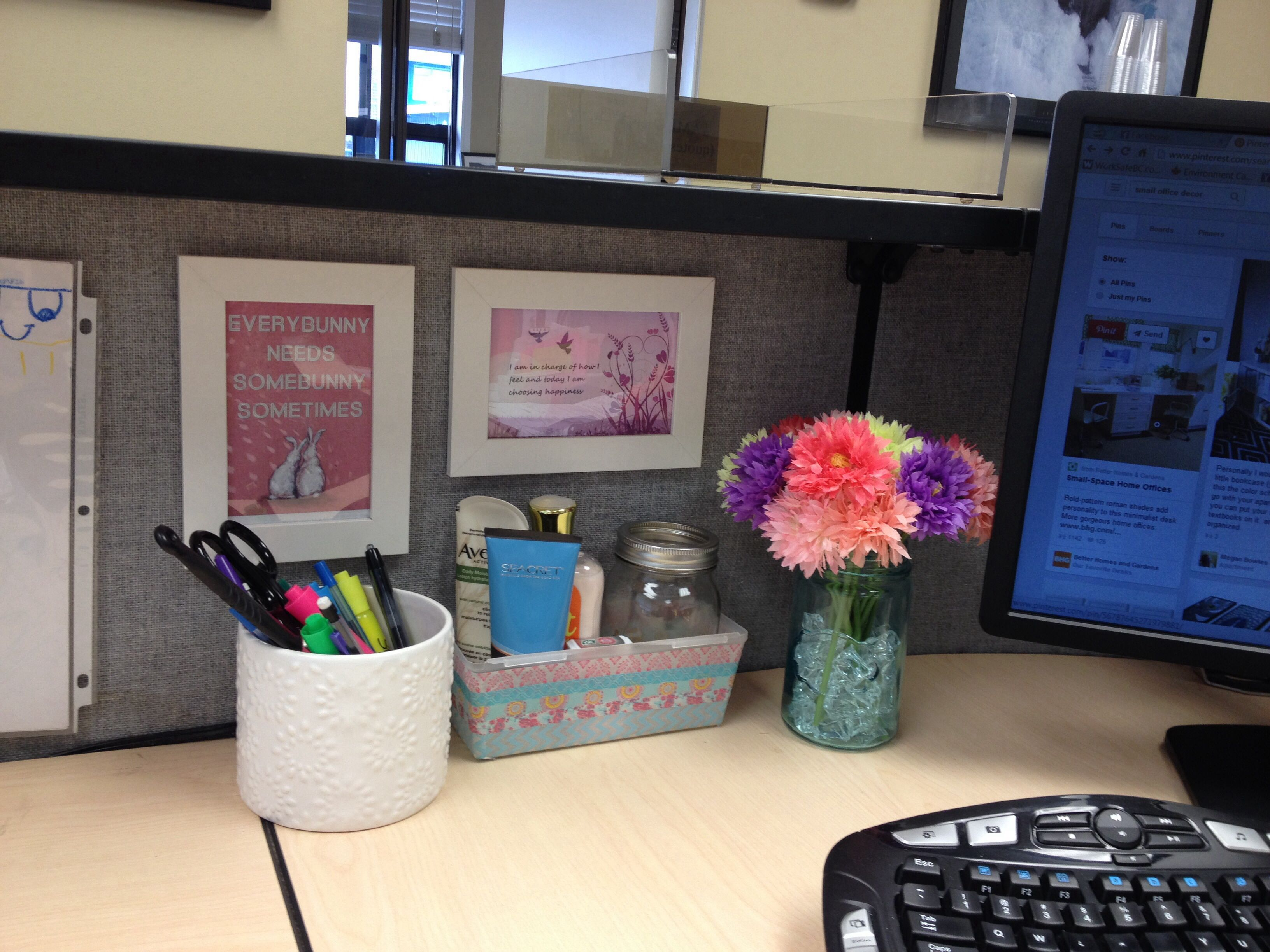 my cubicle decor on a very tiny budget. this is my little happy