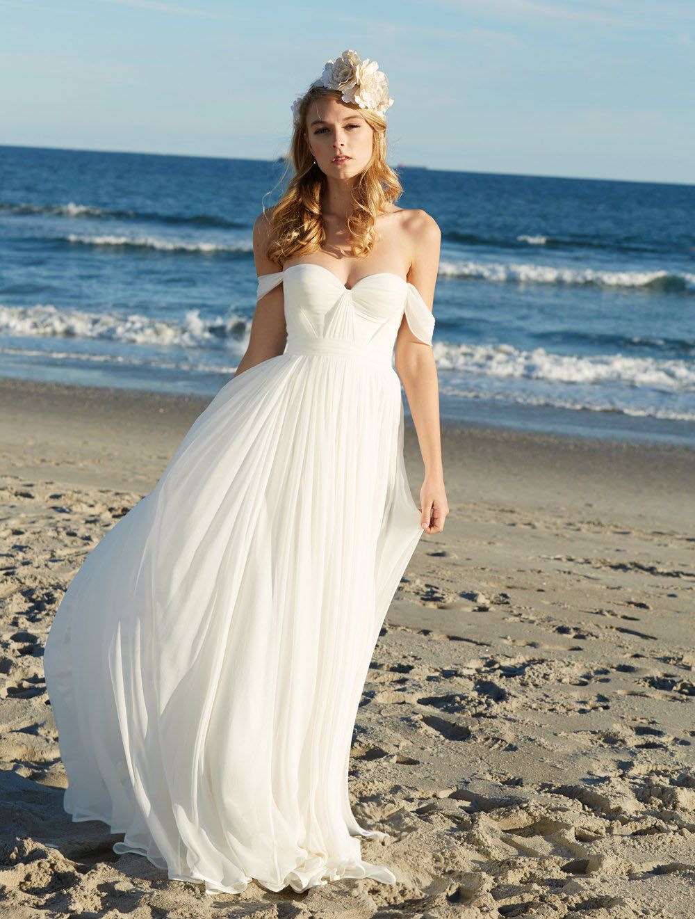 This popular beach chiffon summer wedding dress features off-the ...