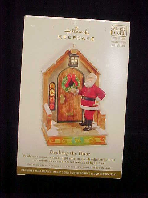 Hallmark 2011 Magic Ornament Decking The Door Santa Once Upon A Christmas | eBay