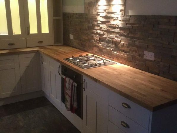 Kitchen Tiles Ideas Pictures Cream Units slate wall tiles with an ivory kitchen and oak worktop. | interior
