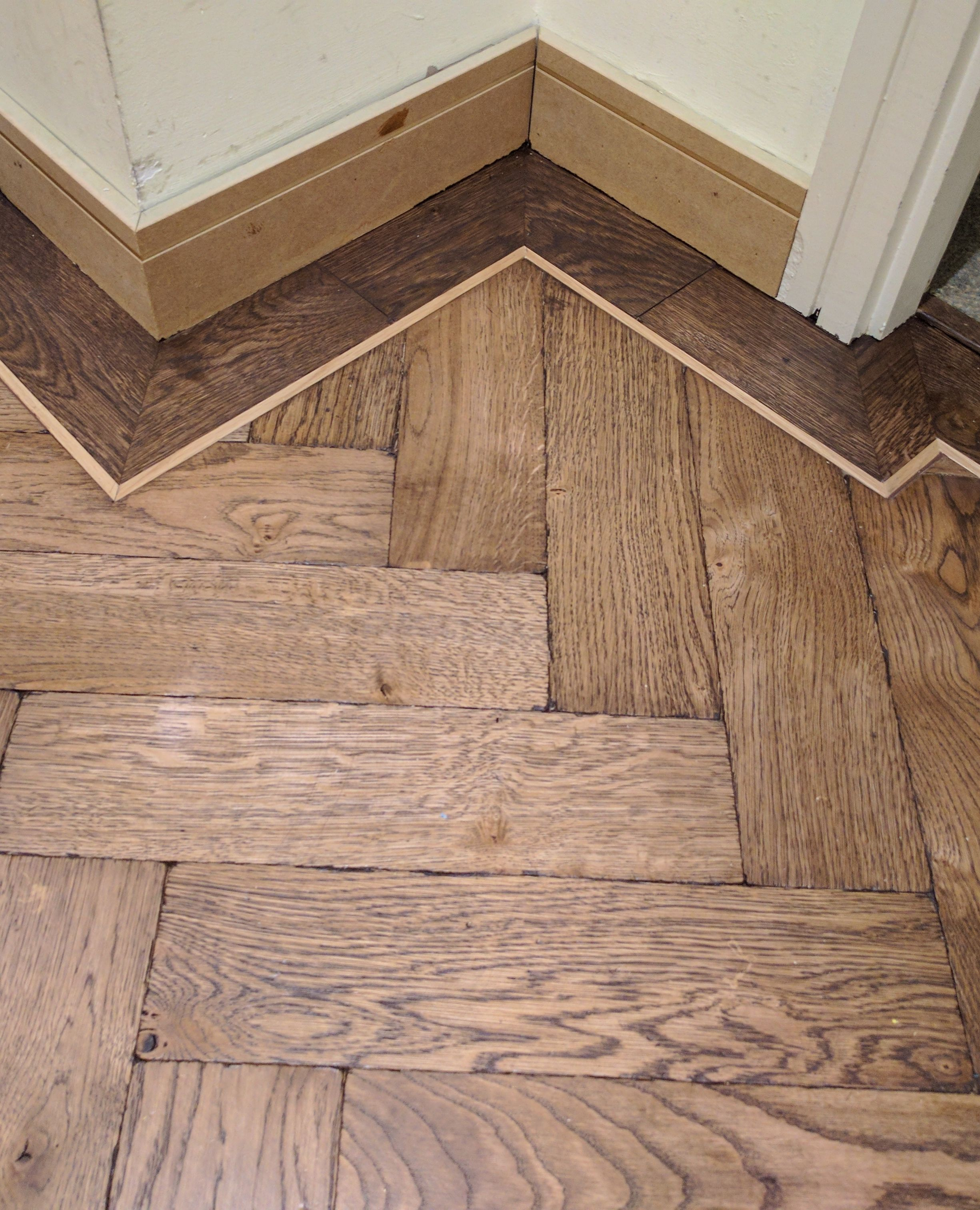 Aged Parquet Wooden Flooring With A Dark Single Border And Light