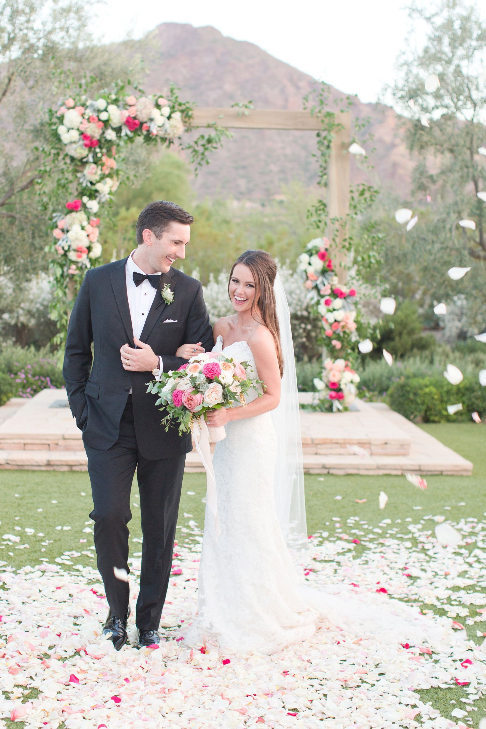 Gorgeous French blue wedding with pops of blush pink and fuchsia. Exquisite floral details, including a floral wrapped alter where they said their vows. This wedding, at one of Arizona's top lush venues, was perfection including a runway of petals for the bride's procession.