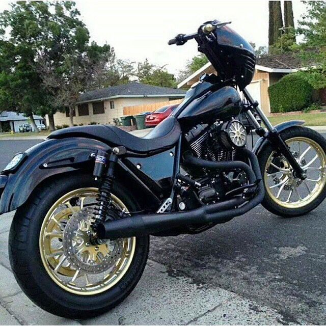 Liking the gold wheels on an otherwise murdered out FXR