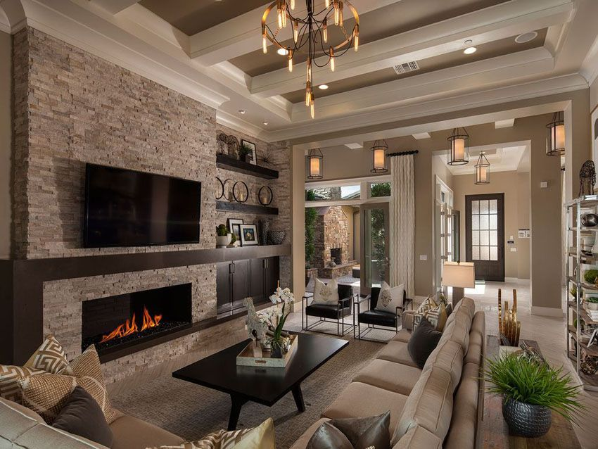 Traditional Living Room With Shades Of Brown Stone Fireplace And High Ceilings Earth Tone Living Room Beautiful Living Rooms High Ceiling Living Room Beautiful living rooms with fireplace