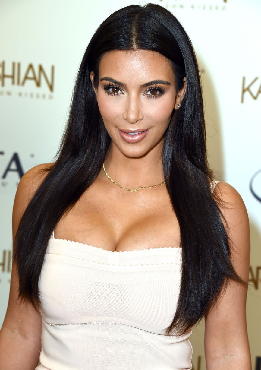 Kim Kardashian Almost Spills Out Of Clinging Dress Days After
