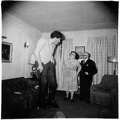 Diane Arbus  A Jewish giant at home with his parents in the Bronx, N.Y.C.