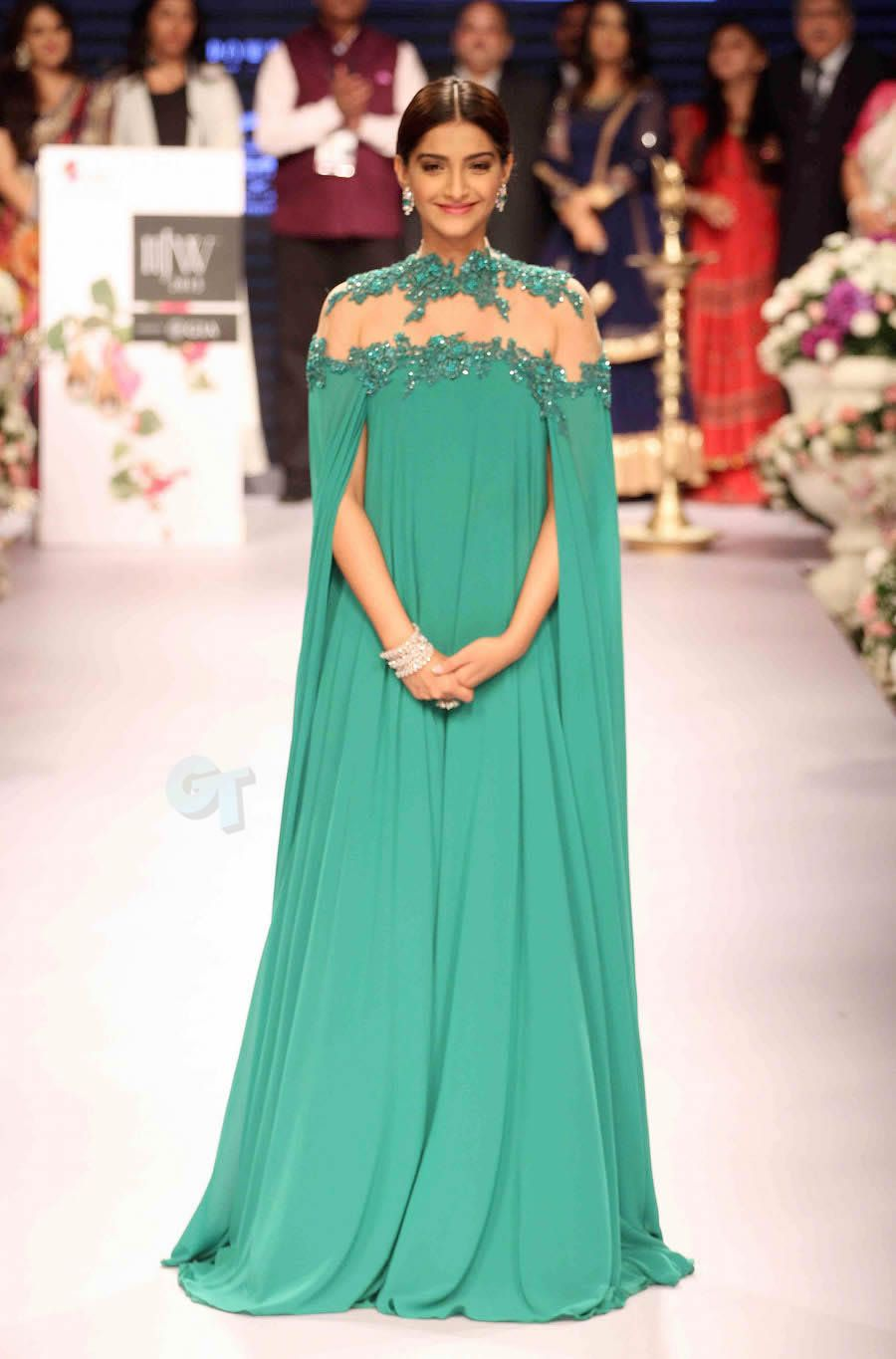 Sonam Kapoor in an emerald green cape gown by Michael Costello at ...