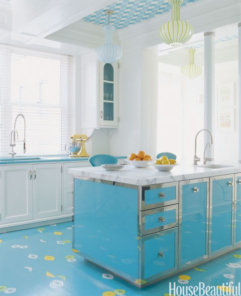 The custom-made island is topped with a two-inch-thick slab of statuary marble in a Manhattan kitchen. All faucets by Dornbracht. The circa-1960 Italian lamps played right into William Diamond and Anthony Baratta's color scheme.