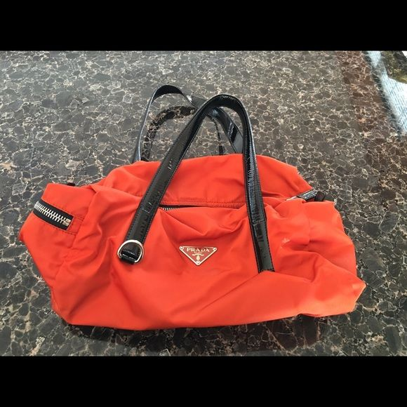b8ae33197f62 Prada orange tessuto purse Prada orange tessuto nylon saffiano black patent  leather handles. Handles have 8