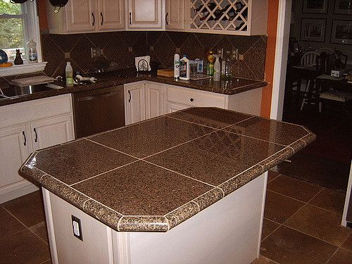 Kitchen remodel with Granite tile countertops and travertine floor tile