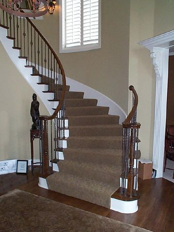 Curved Staircase With Iron Spindles