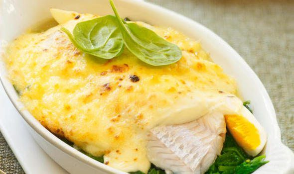 INGREDIENTS  675g haddock fillet  150ml fish stock  300ml milk  45g butter, plus extra for greasing  45g plain flour  115g Cheddar cheese, grated  Seasoning  250g spinach, chopped  Grated nutmeg, pinch  60g fresh wholemeal breadcrumbs  2 tablespoons chopped parsley  60g parmesan cheese, grated    Haddock mornay recipe    METHOD  1) Cut haddock into four