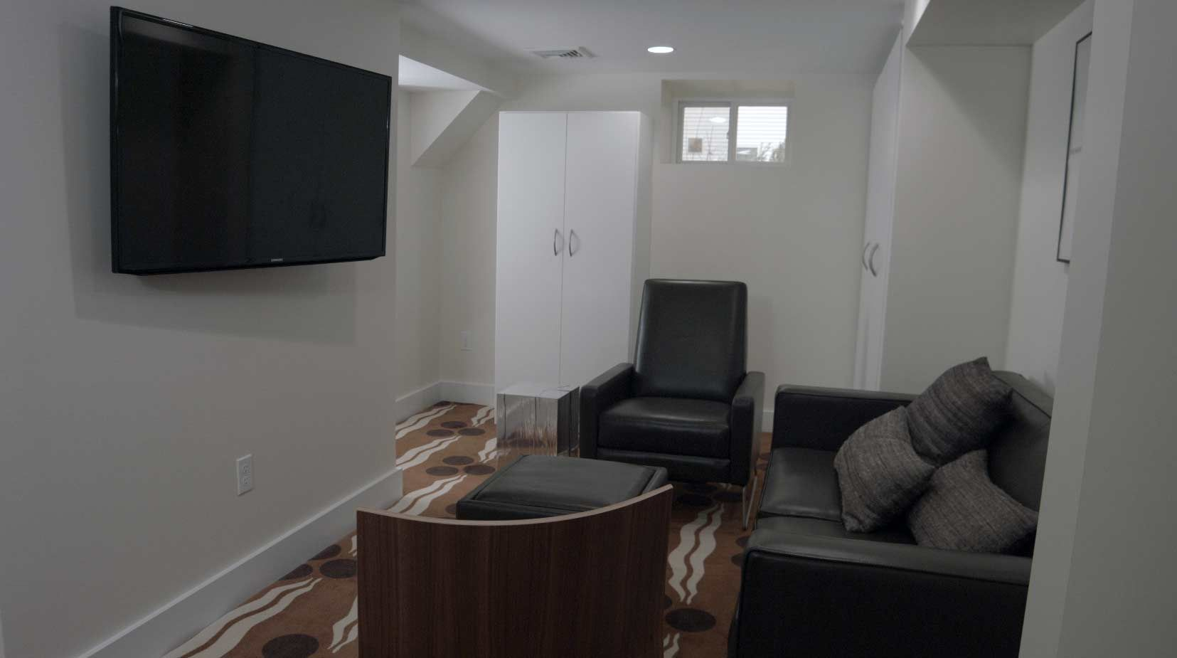 The TV area has comfortable seating and big screen TV, as well as room for the kids to play. @george2rescue