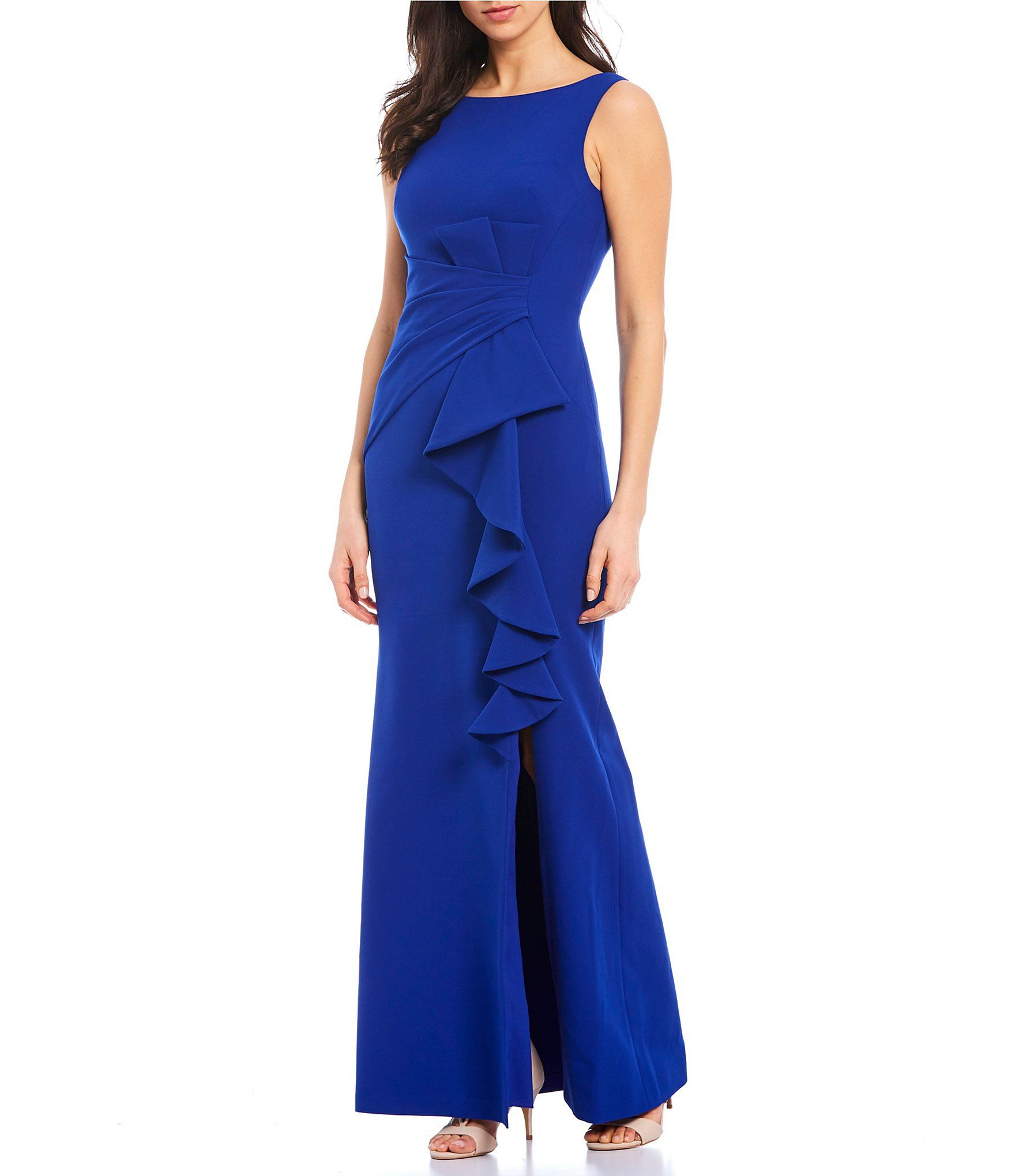 From Eliza J, this gown features:Boat necklineSleevelessPleated gathers at waistRuffle front detailFully linedstraight hemline with front slit detail Invisible zip back closurePolyester/spandexDry clean Imported.