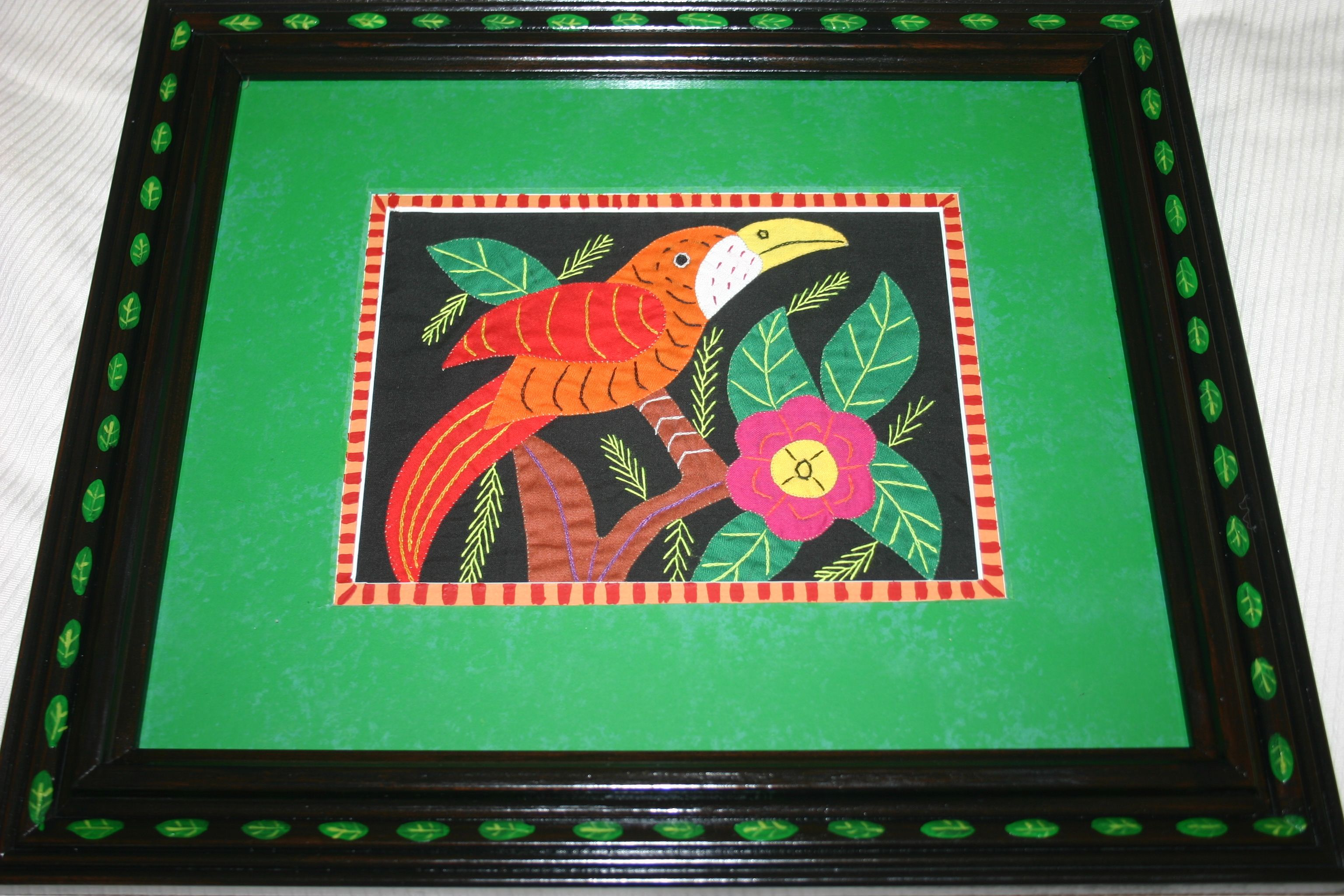 Molas are extremely colorful and uplifting when used in home design. I hand paint one of a kind signed custom frames, made to match and enhance each mola  cheetahdmr@aol.com