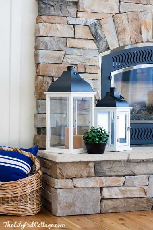 Lake House Decor - my mom's sunny living room - The Lilypad Cottage. Love the rock fireplace...
