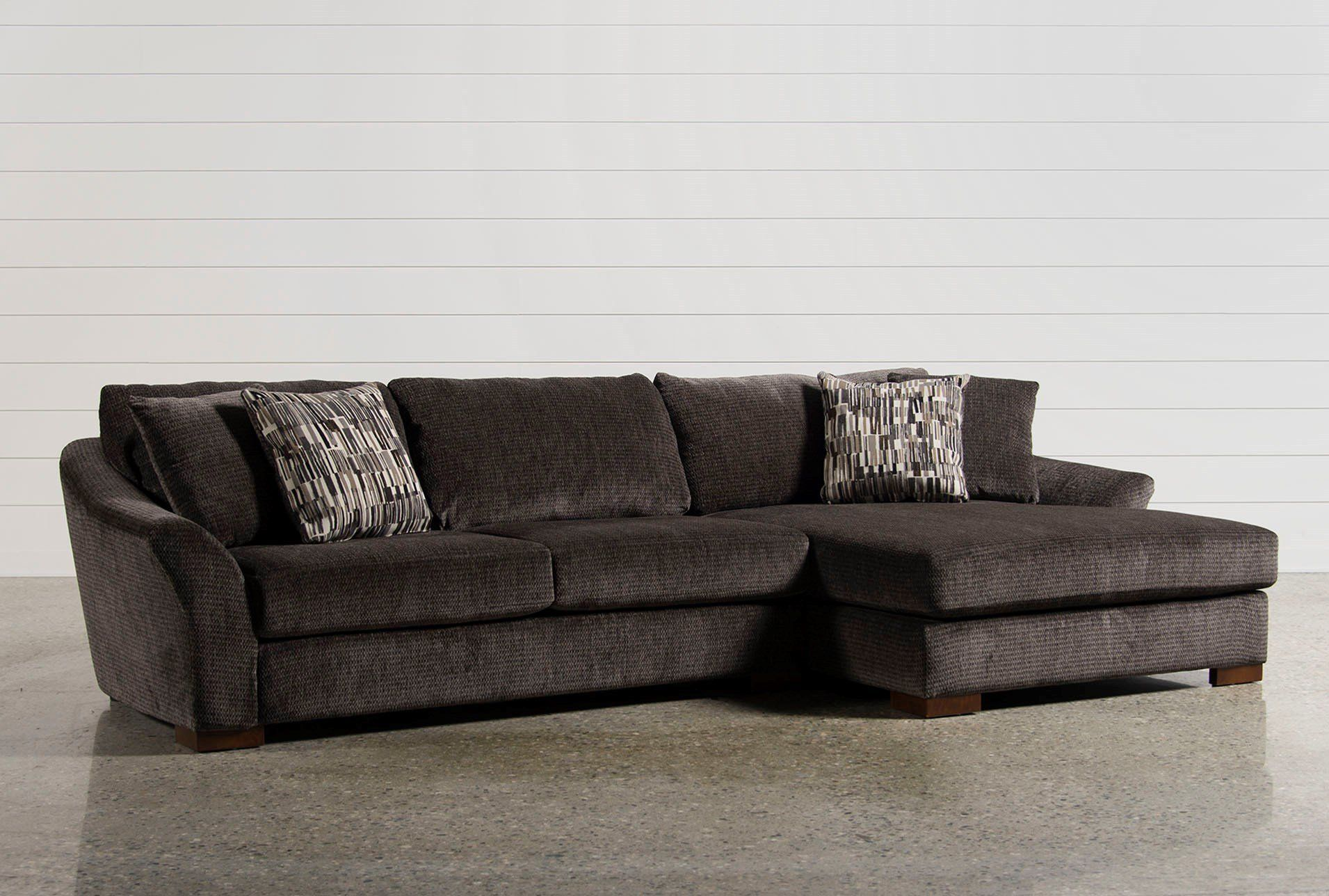 Two pieces make perfect on our cozy evan sectional featuring casually curved sides for resting heads and leaning arms the sofa and oversized chaise