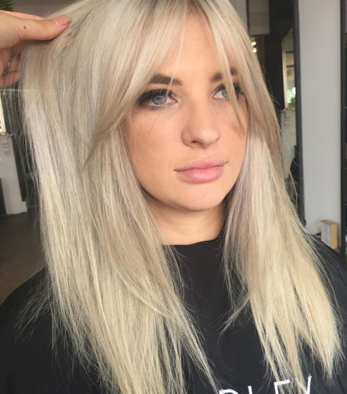 Blonde Platinum Silver Hair Color And Curtain Bangs Hairstyles Hair Styles Blonde Hair With Bangs Long Hair Styles