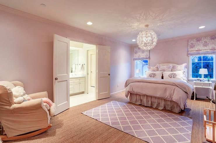 Pink And Purple S Bedroom Features Walls Lined With A White Tufted Headboard On Queen